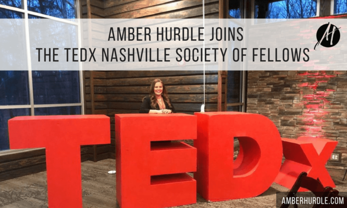 Amber Hurdle in front of TEDx sign